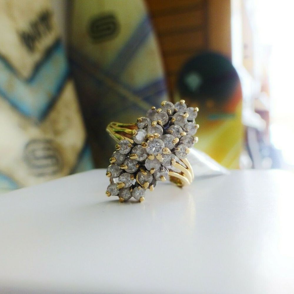 Round Diamond Cluster Waterfall ring prong set in yellow gold