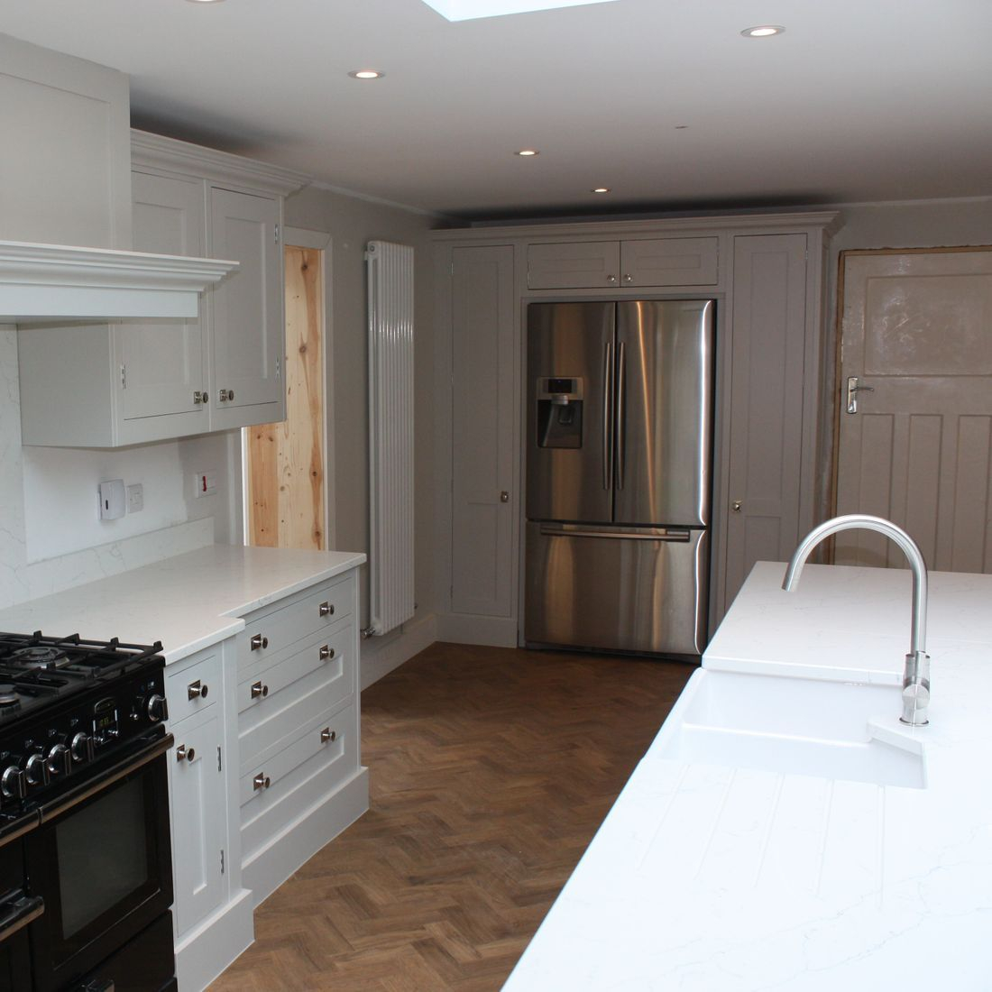 In-Frame Shaker Style Kitchen With American Fridge Freezer Housing