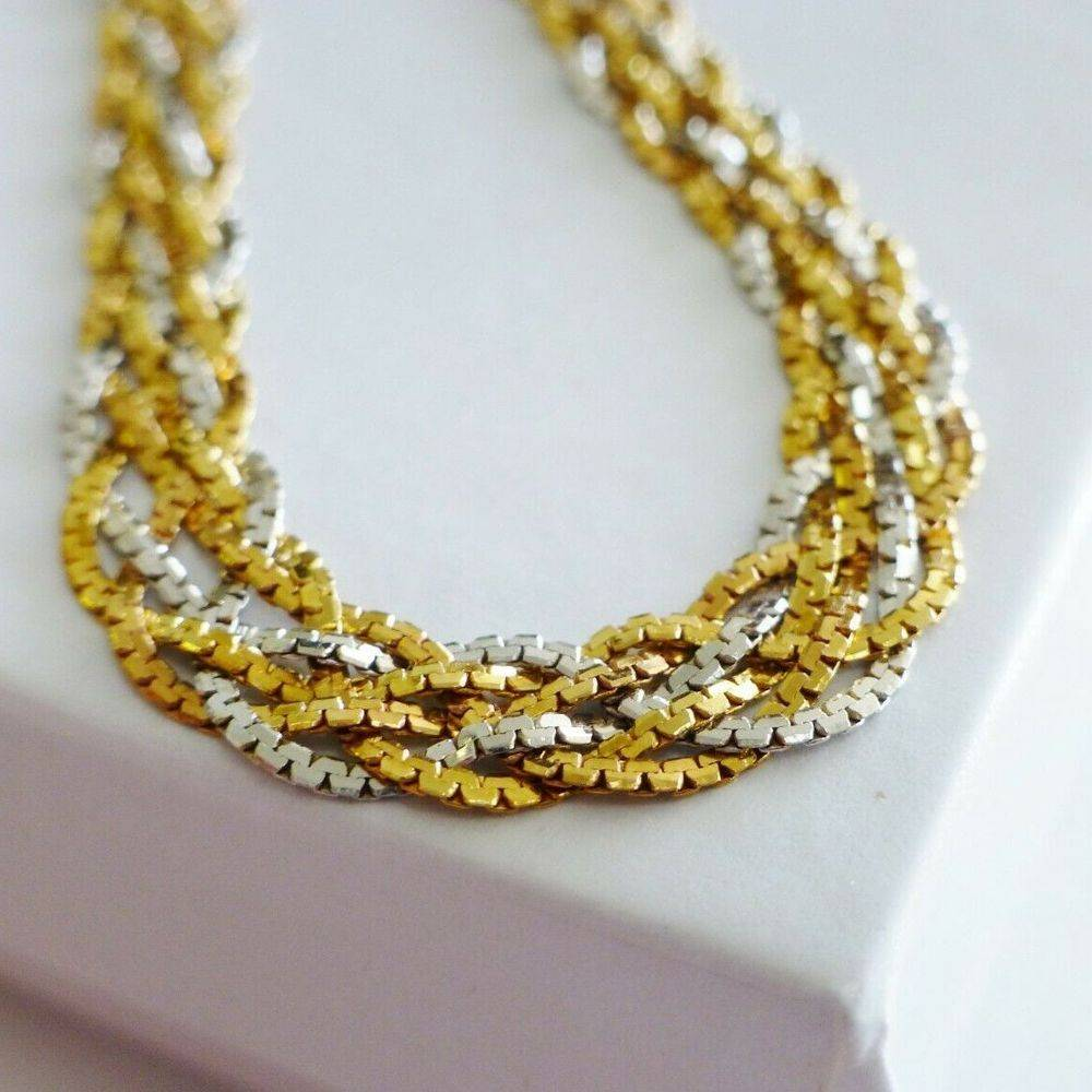 6 strand necklace, braided with yellow and white gold alternating