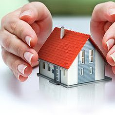 Hands protecting home and property