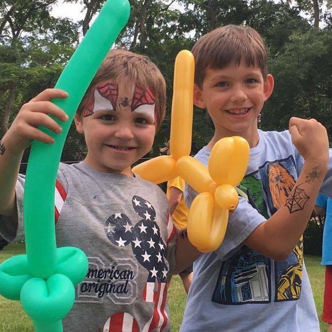little boys holding balloons