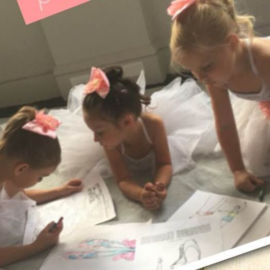 Ballet students color backstage before performing at the Bing Crosby Theater in downtown Spokane
