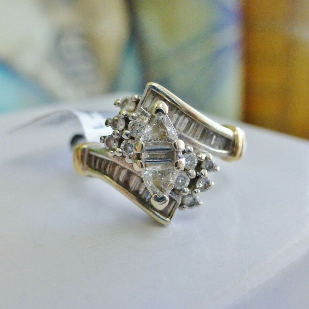 Round and Baguette diamond compsite engagement ring in yellow and white gold