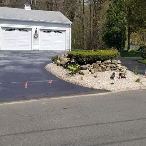 Repaired driveway; paved saw-cut area.