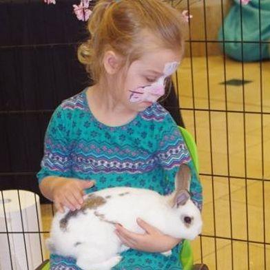 Child holding bunny