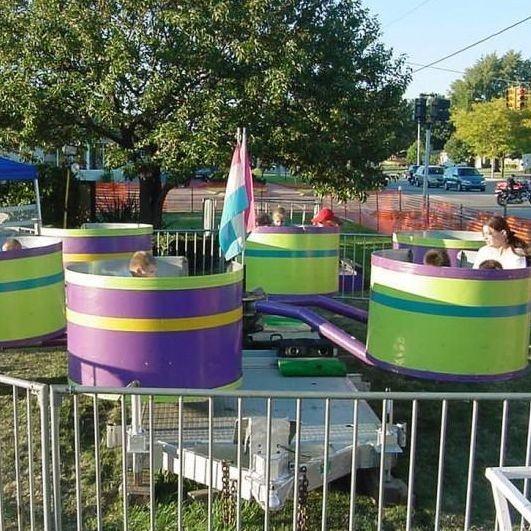 Kids riding in tubs of fun ride at a fair