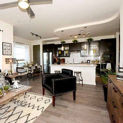 Image of apartment living room, kitchen, tray ceilings, wood flooring, in Washington Corridor area of Heights