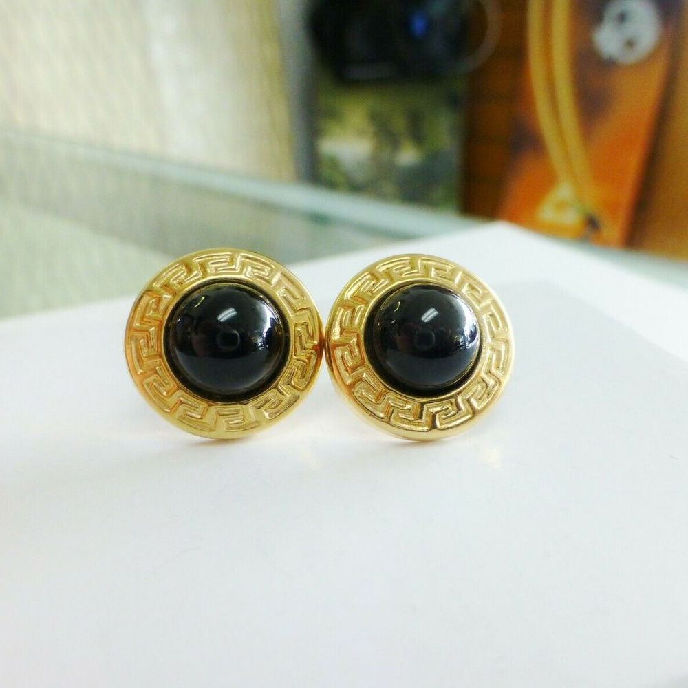 Greek key link yellow gold frame around dome shape black onyx earrings