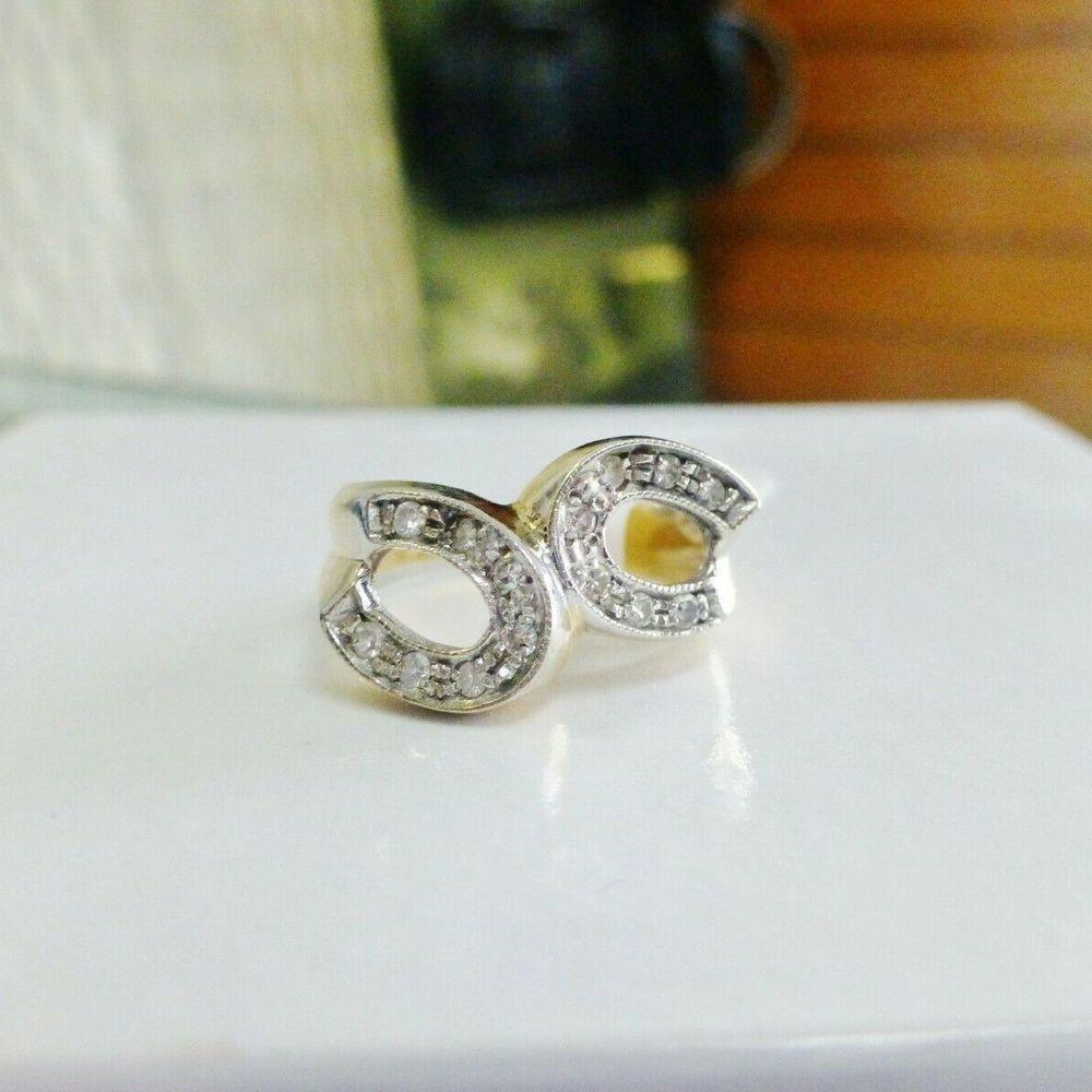 two tone gold round diamond double horseshoe ring