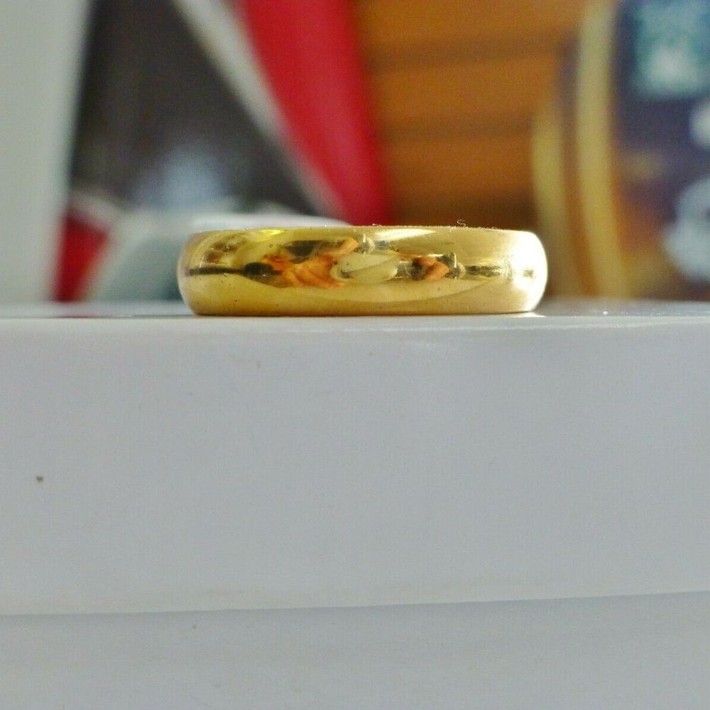 Polished Yellow gold mens wedding band on a white box for sale