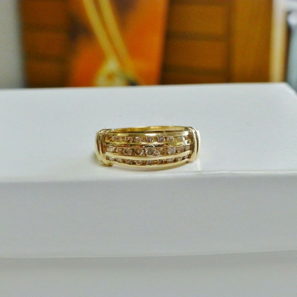 Three Rows of Round Diamonds Channel Set in a Yellow Gold Wedding Band