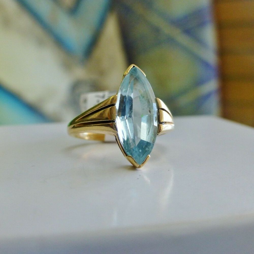 Marquise Cut Blue Topaz Solitaire Prong Set in Yellow gold on a white box