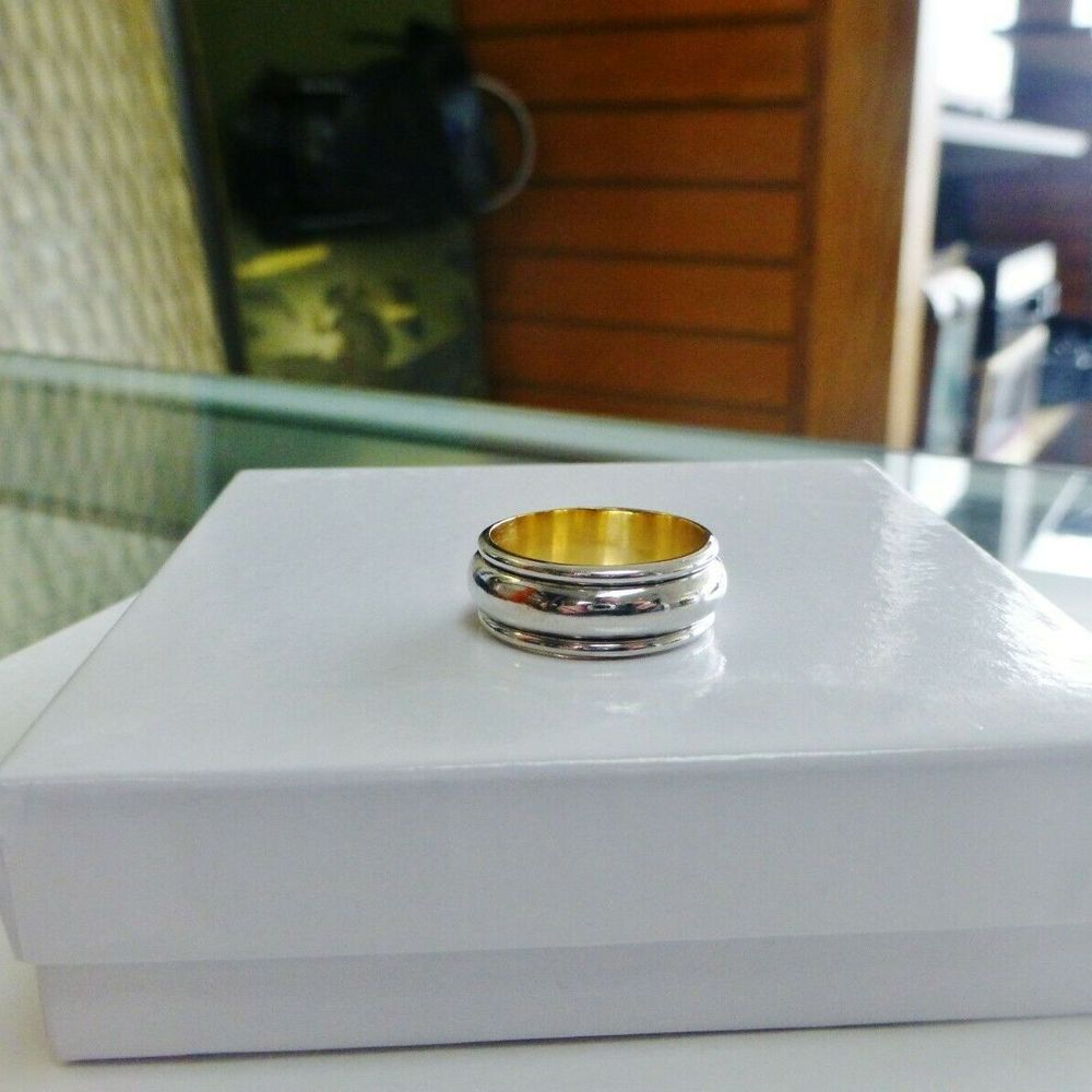 Platinum and Yellow Gold mens domed wedding band on a white box