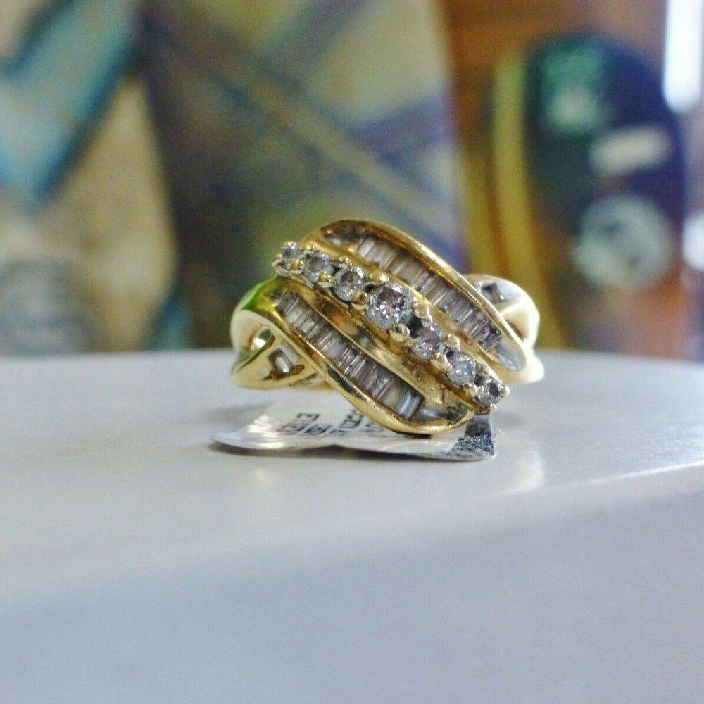 yellow gold round and baguette diamond cluster swirl ring