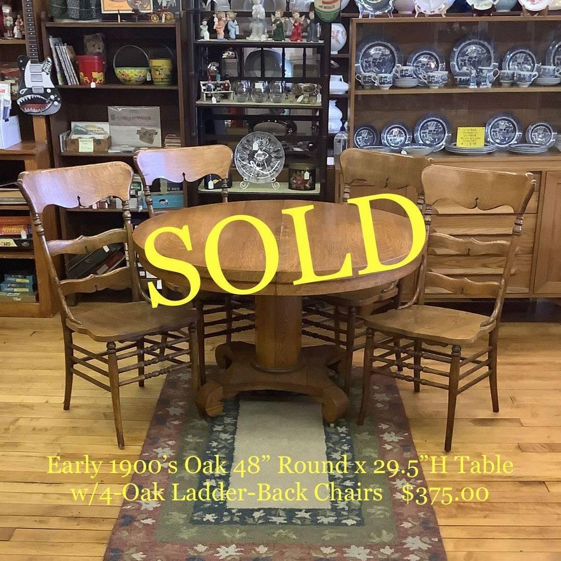 "Early 1900's Oak 48"" Round Table w/4- Ladder-Back Oak Chairs  $375.00"