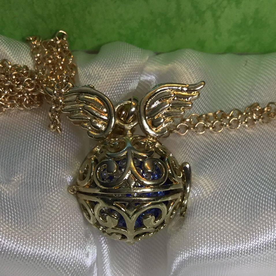 angel winged, gold toned, pendant, locket, harmony ball, necklace, chain, charity, blue and white rhinestone, jingle, harmony, filigree