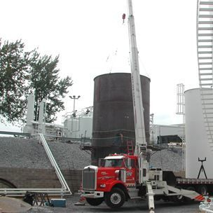 Setting new shell ring on API 650 welded steel storage tank.