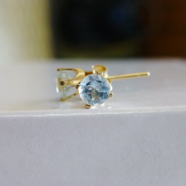 Round Sky Blue Topaz Prong Set in yellow gold post earrings