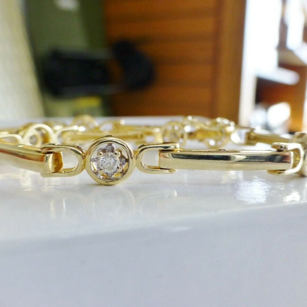 Round Cut Diamond Prong Set in a Bar Link Yellow Gold Tennis Style Bracelet