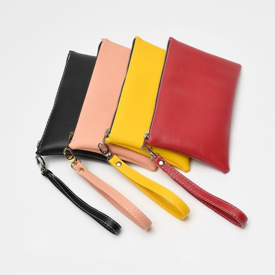 black wristlet, wristlet, leather bag, designer bag, black clutch, black bag, black purse