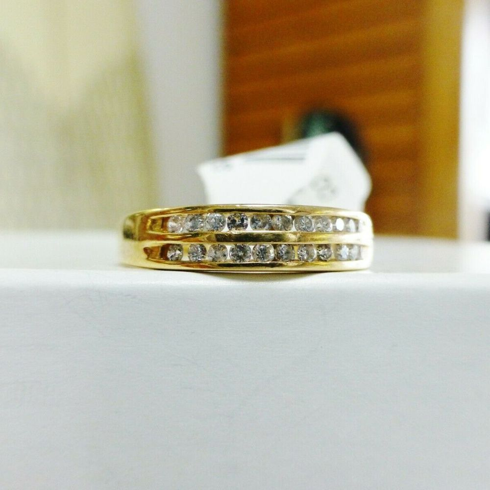 Two rows of round diamond channel set in a yellow gold wedding band