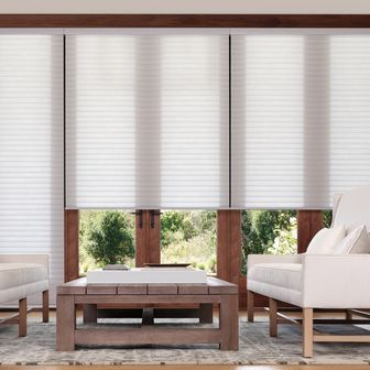 Beauty meets convenience with Hunter Douglas SoftTouch Motorization. These battery-powered shades are operated with the simple touch of a wand.