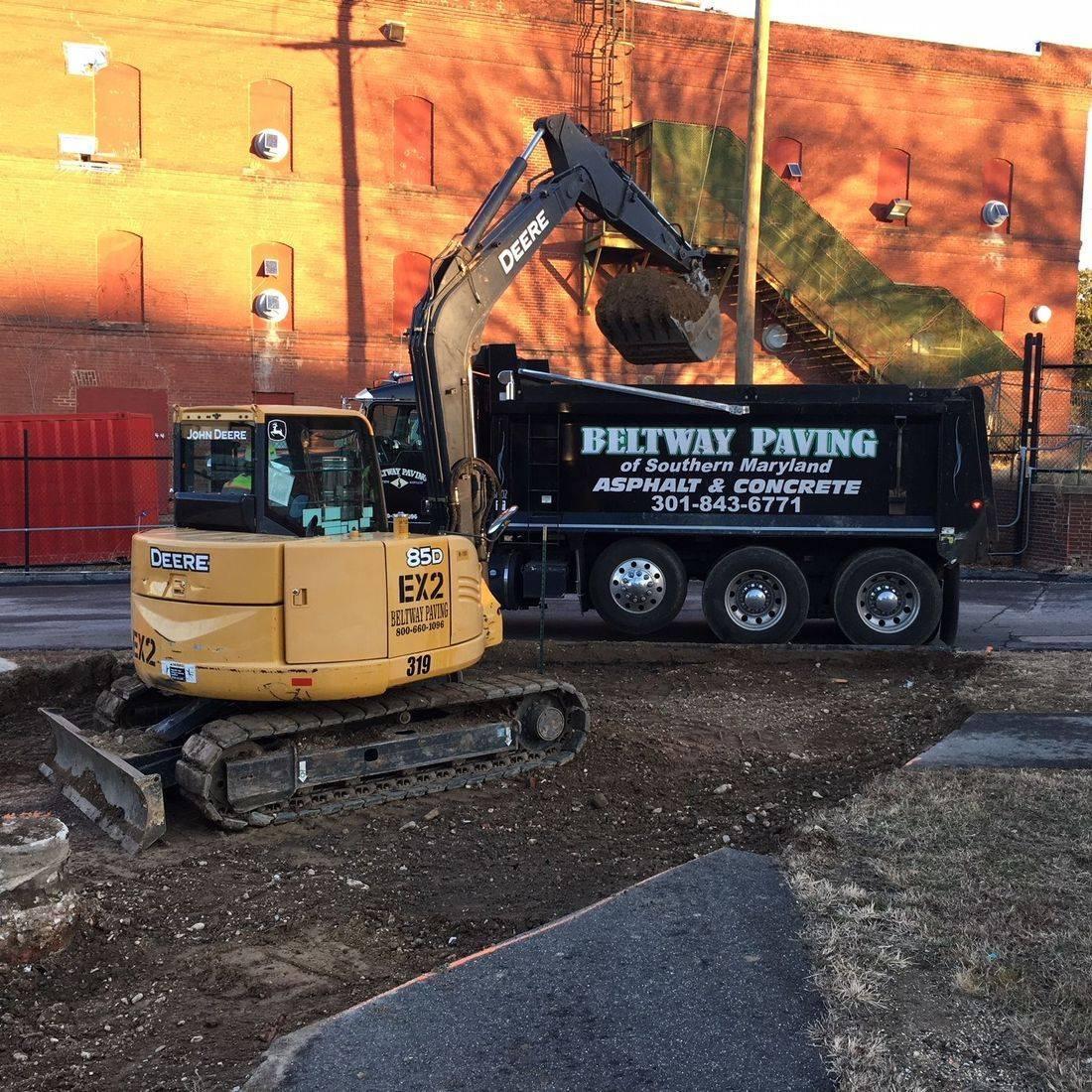 Loading dirt into dump truck