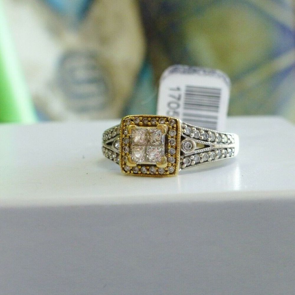 White Gold Split shank engagement ring with a yellow gold diamond framed princess cut quad center