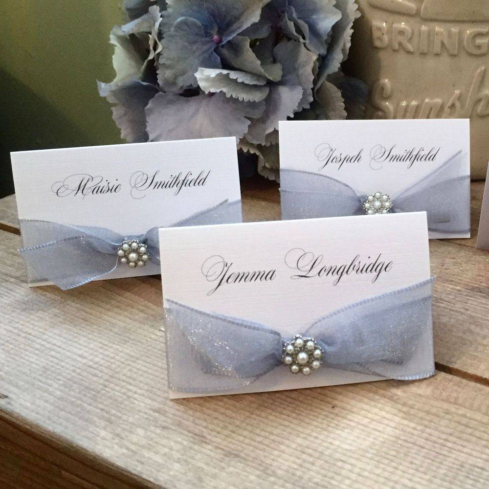 Place name with silver grey ribbon and pearls
