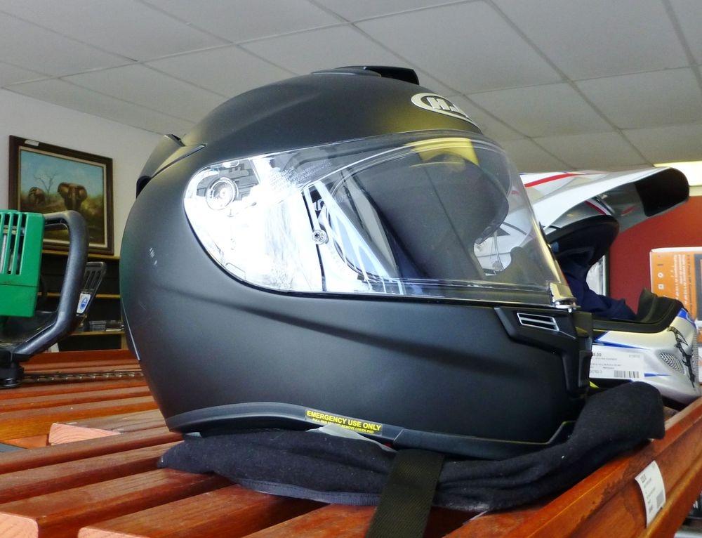 close up picture of a matte black HJC helmet on a shelf