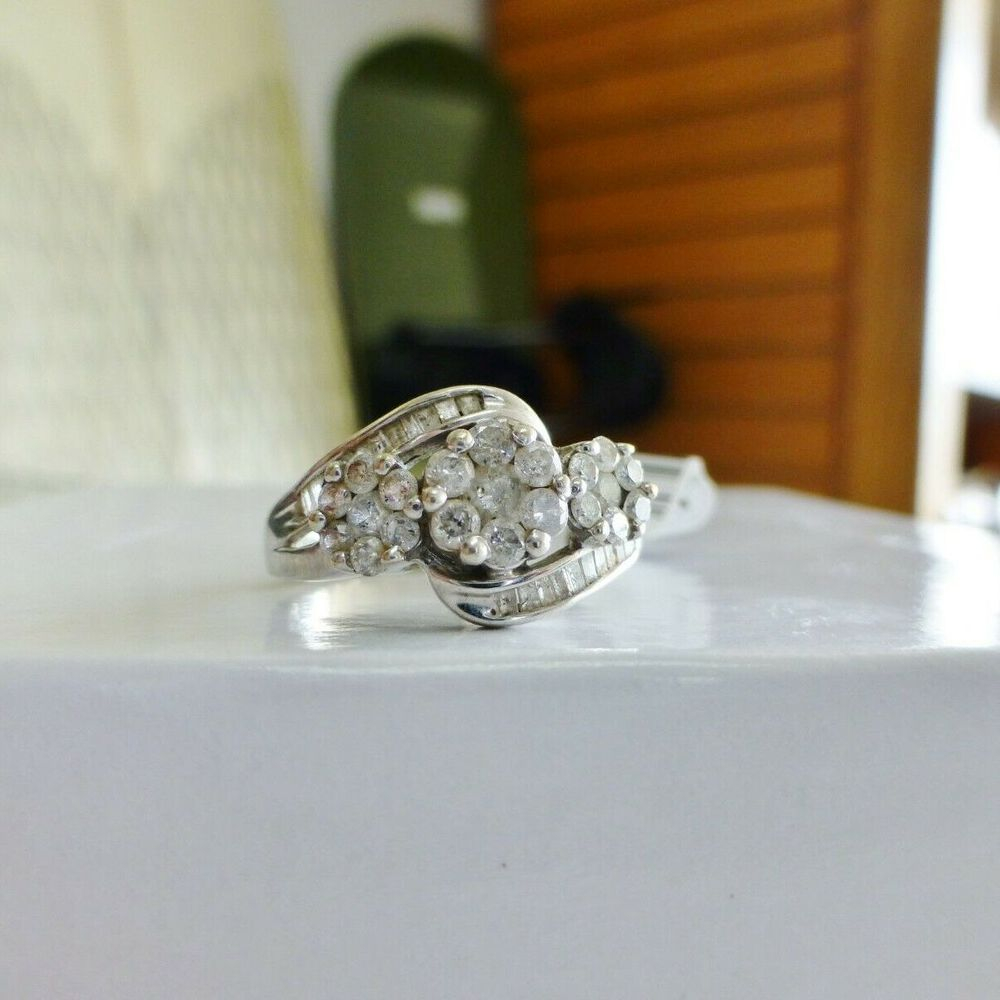 Round and Baguette Diamond Composite Three Stone Swirl Engagement Ring