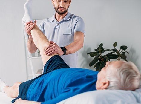 PT holding a patients leg