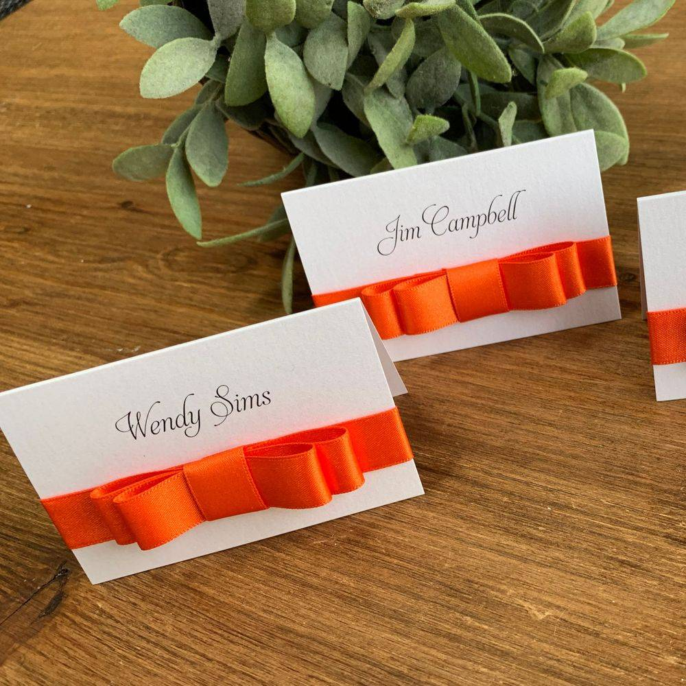 White and burnt orange place name,  wedding uest place name