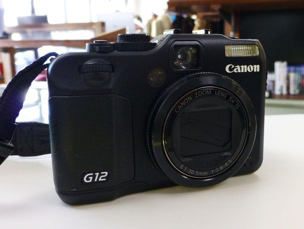 Closeup Picture of a Black Canon G12 Digital Camera with Strap