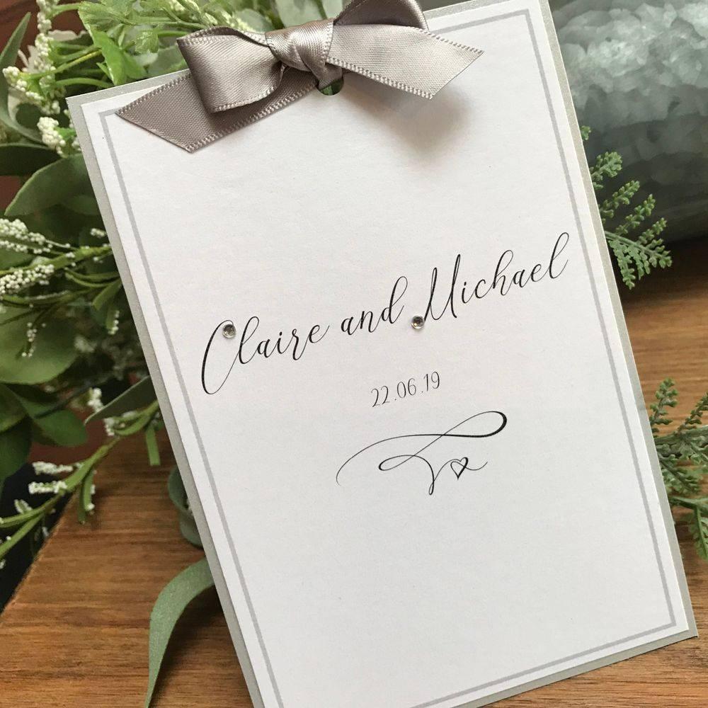 Silver and white wedding invitation