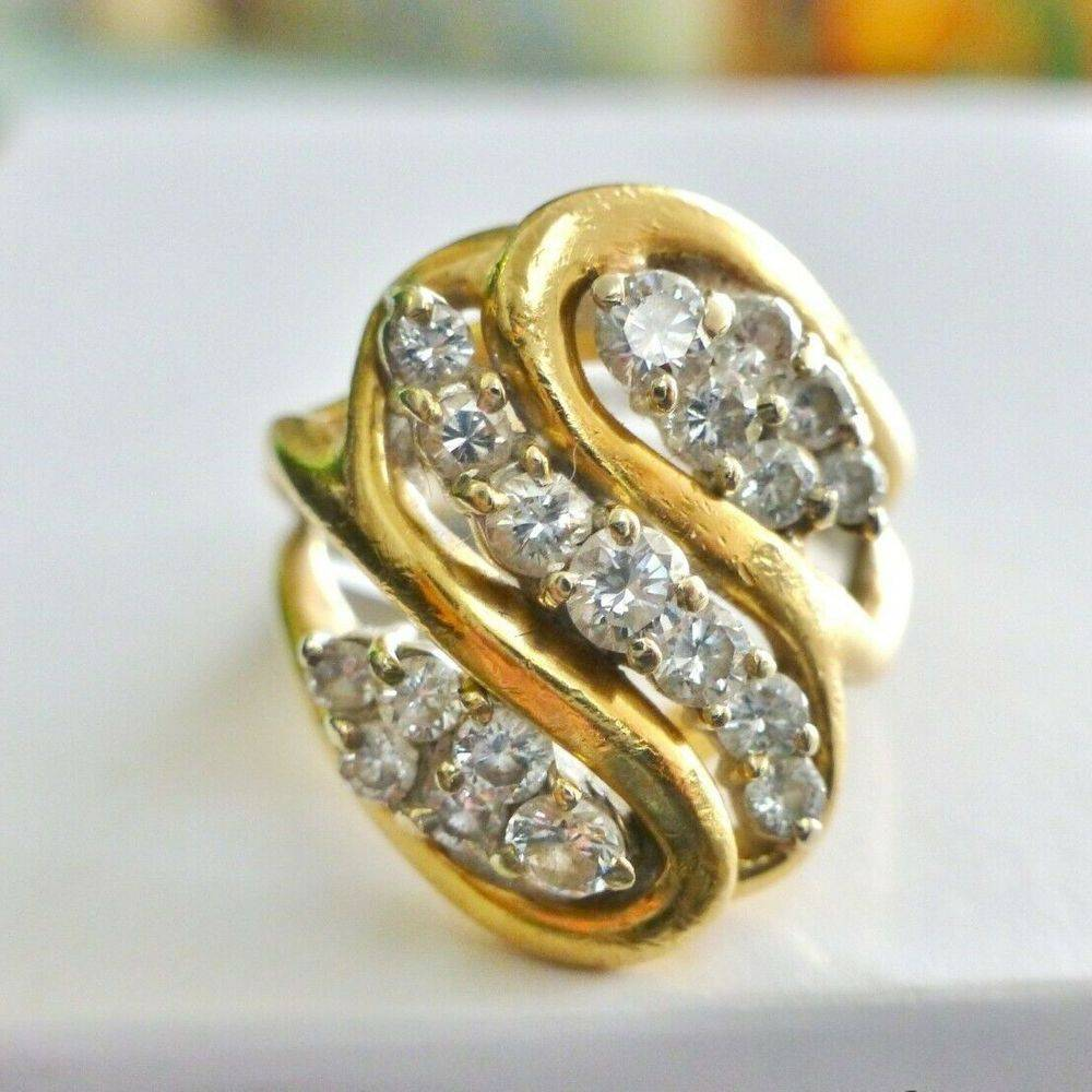 Round Diamond Cluster Prong Set in a Yellow Gold Swirling Ring