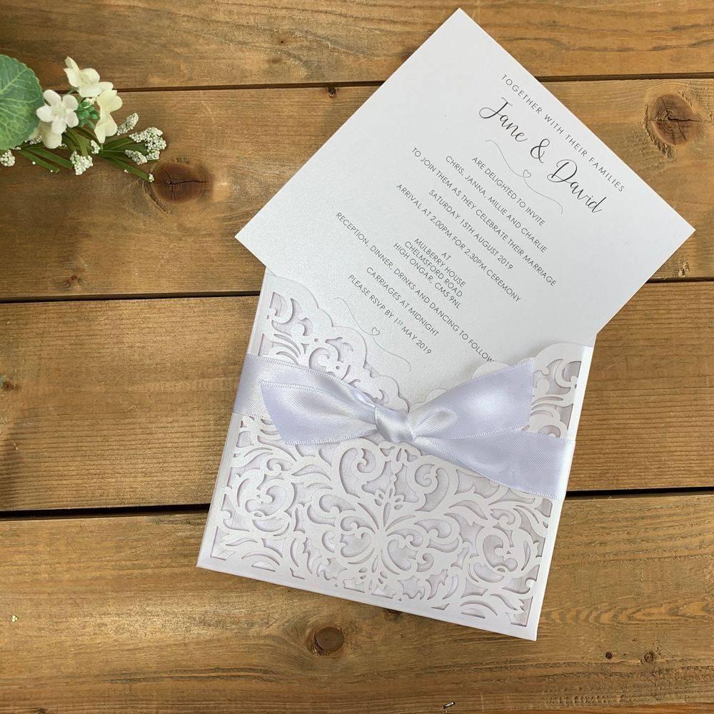 Laser cut wedding invitations in white