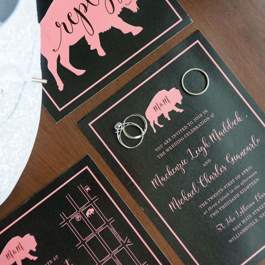 Overhead view of Buffalo themed wedding invitations with map rings and sparkly wedding shoes
