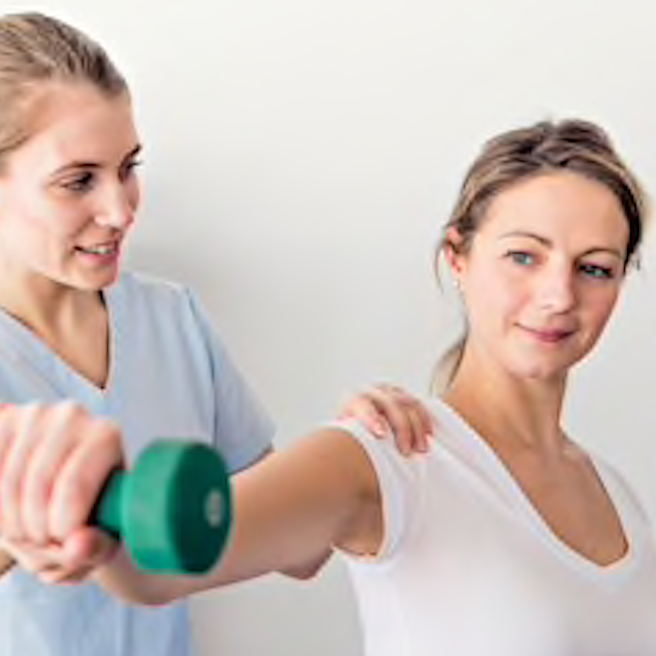 Physiotherapist showing a patient how to use weights