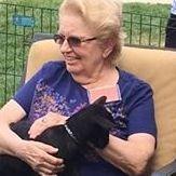 senior woman and goat