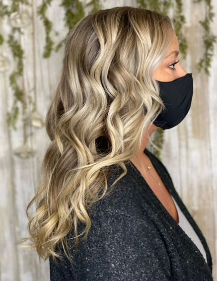 Long Leyered Cut.. Very natural Balayage color.. Styled with loose Beach waves