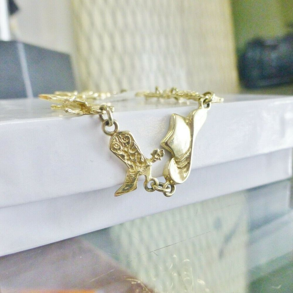 Cowgirl Hat, Boots and Horses Linked across a yellow gold bracelet