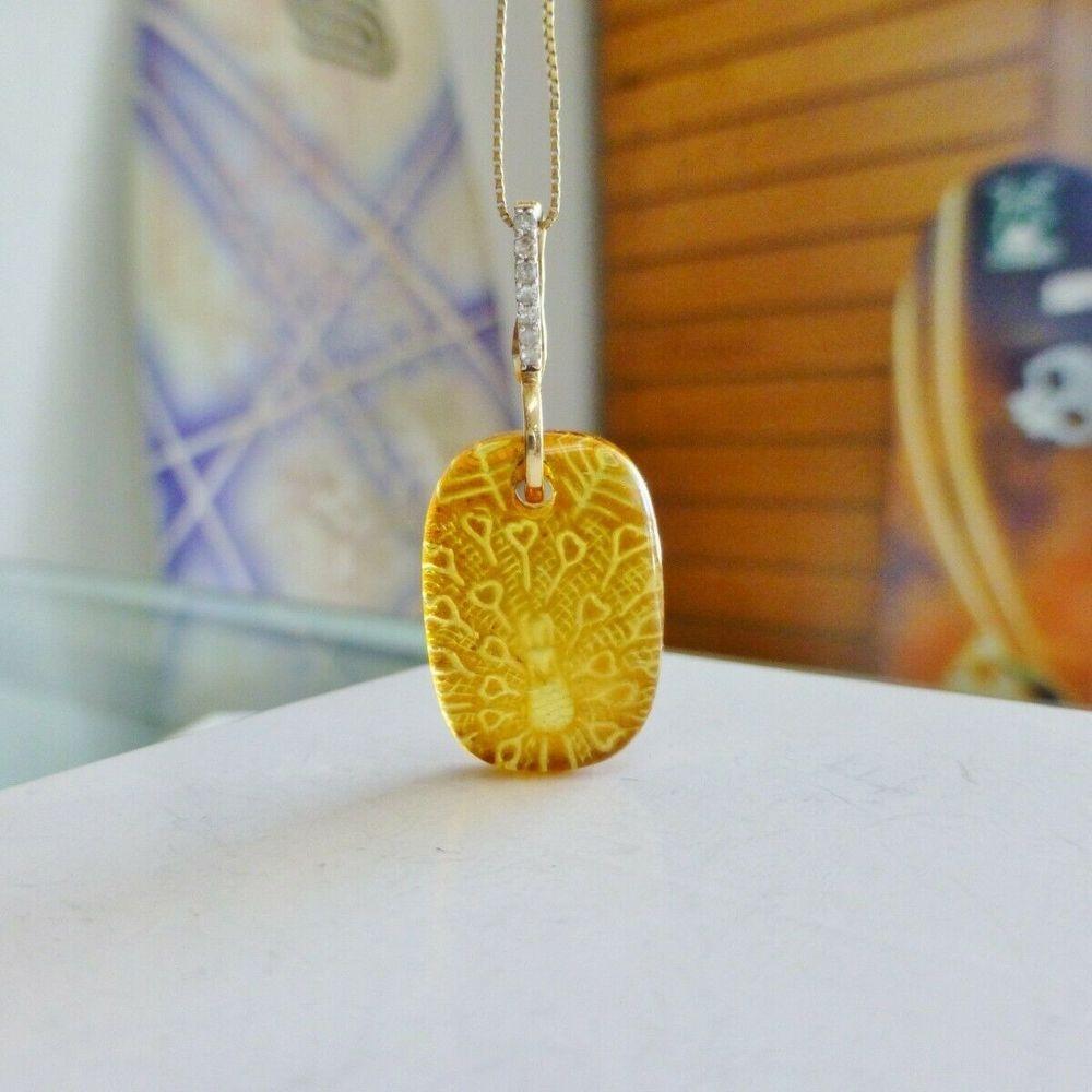 Rectangular Baltic Amber Diamond Accent Charm on a white jewelry box