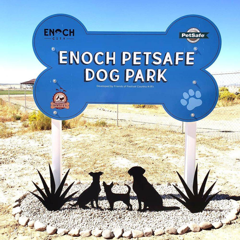 Enoch dog park sign. Blue bone with text