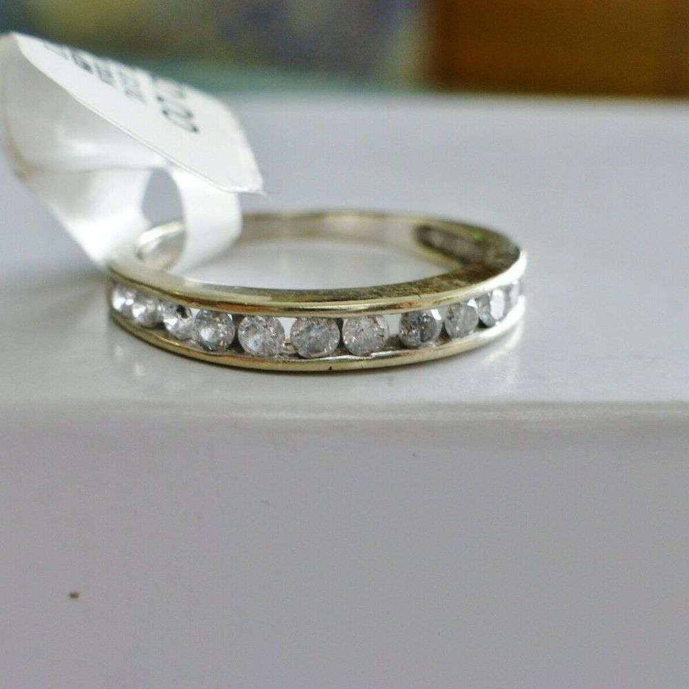 Round Diamonds Channel Set in a ladies white gold band