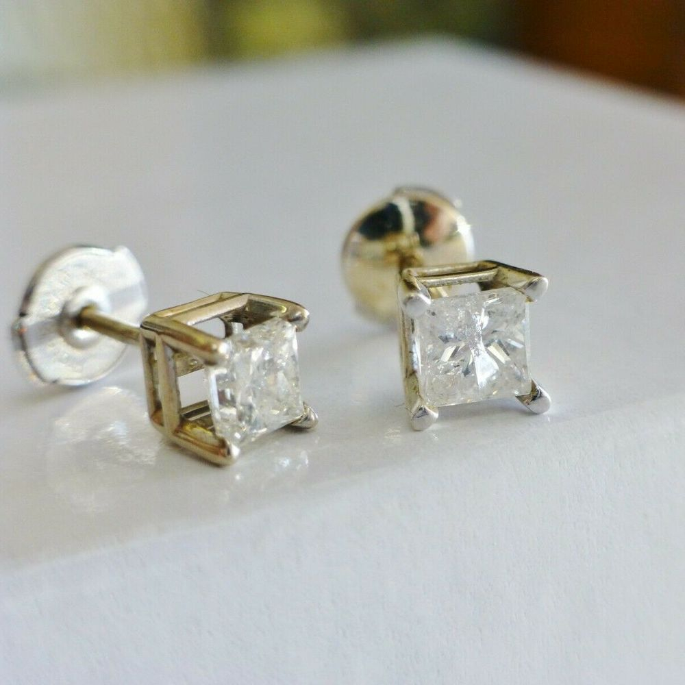 A Pair of Princess Cut Diamonds Prong Set in White Gold Stud Earrings