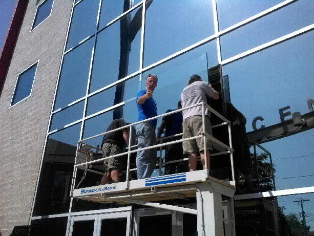 Commercial Glass Repairs Should only be done by Profesionals Glaziers. Here is a large Window being installed by Our Team.We are located in Philly