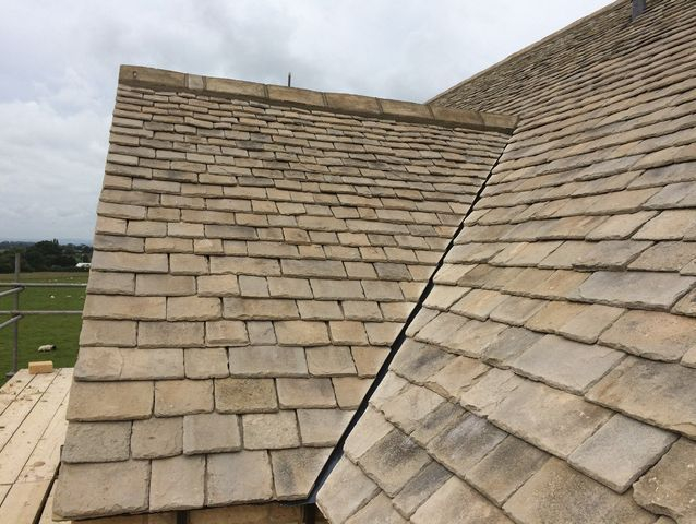 Stone roofing tiles