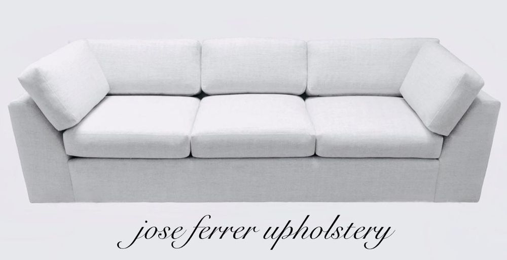 modern sofa recovered in white linen