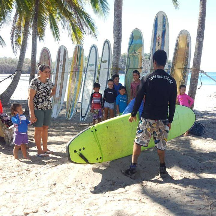Chillasana Yoga Surf in Playa Carrillo.  Local Kids enjoying their free surf lessons.